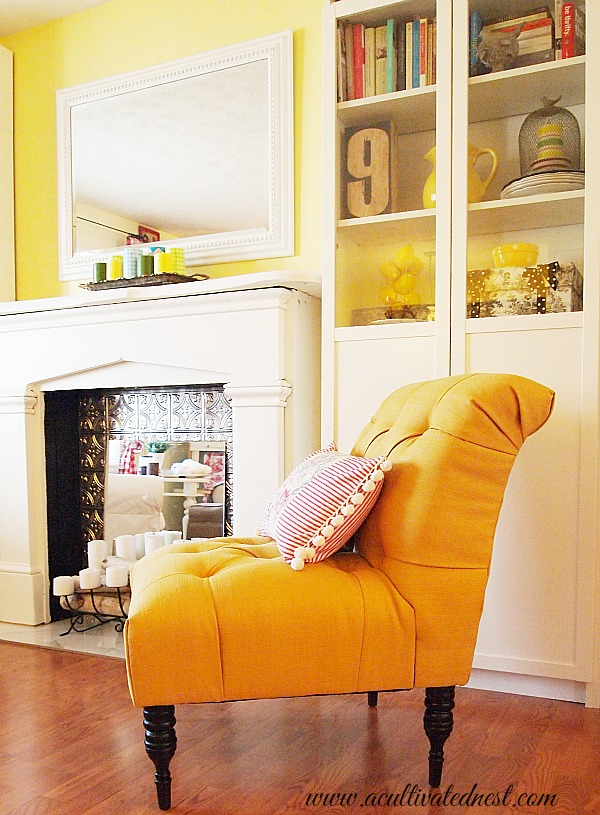 side view of yellow tufted accent chair