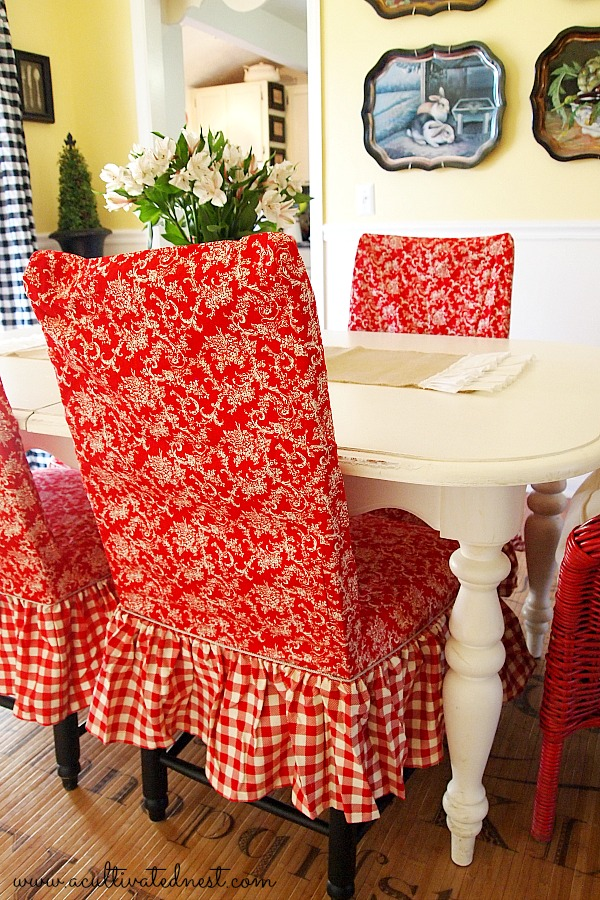 red toile and checks slipcovered dining room chairs