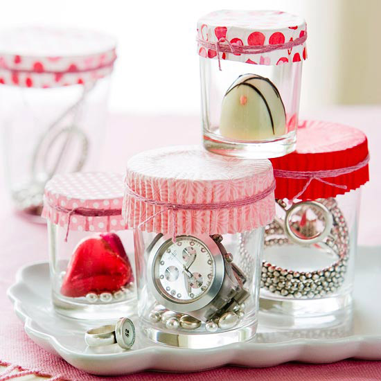 use a cupcake liner as a wrapper for gifts in a jar