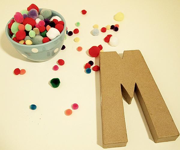pom pom to cover cardboard letter