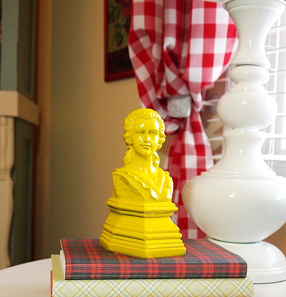 yellow bust of woman bookend