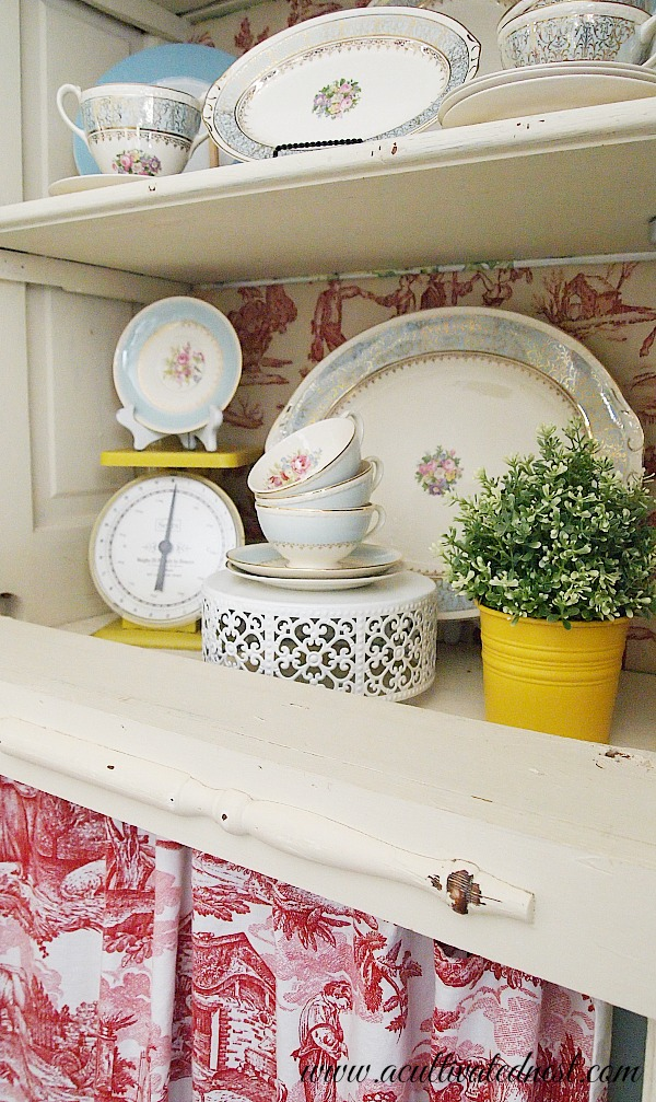 china cabinet with vintage yellow scale