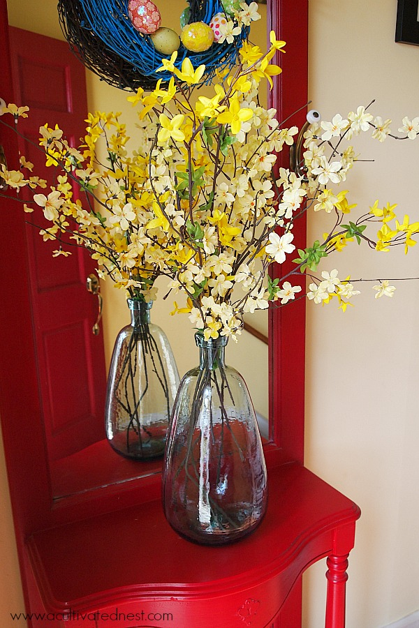 Forsythia branches in a blue glass vase