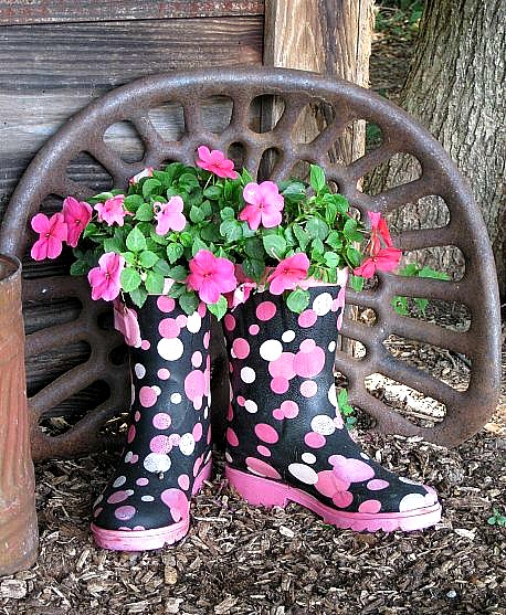 pink flowers planted in rain boots via Hometalk
