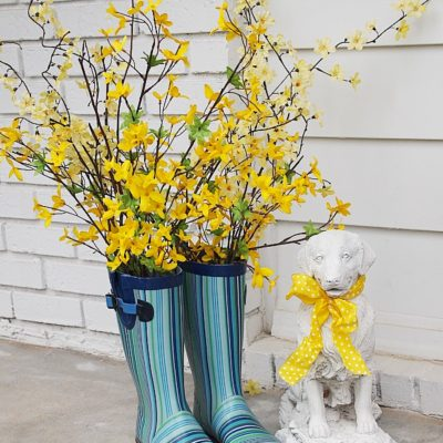 rain boots with forsythia branches