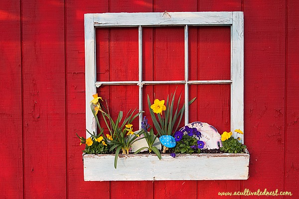 Whimsical spring window box with vintage plates
