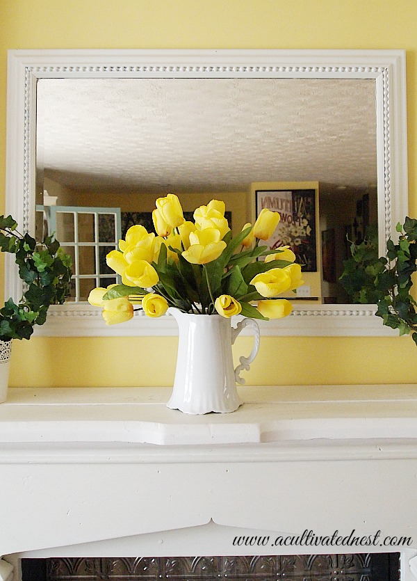 Spring decor - faux yellow tulips in a white pitcher