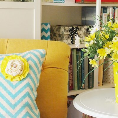 Spring Decorations - aqua chevron pillow with yellow rosette
