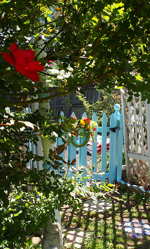 blue garden gate to the vegetable garden