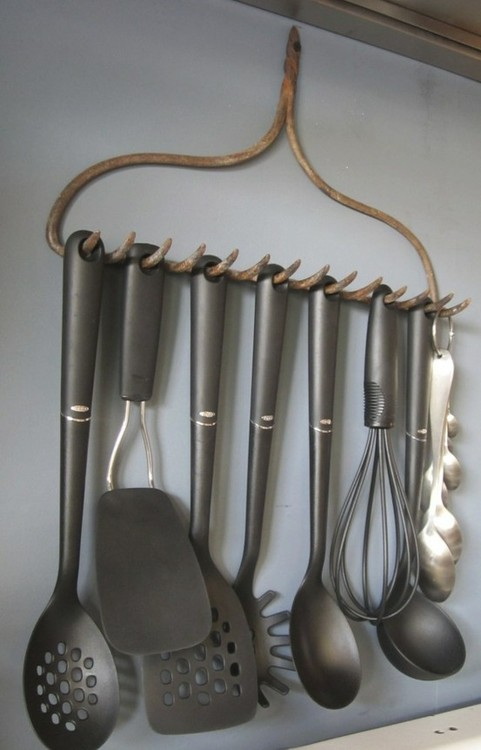 rake upcycled to hold kitchen utensils