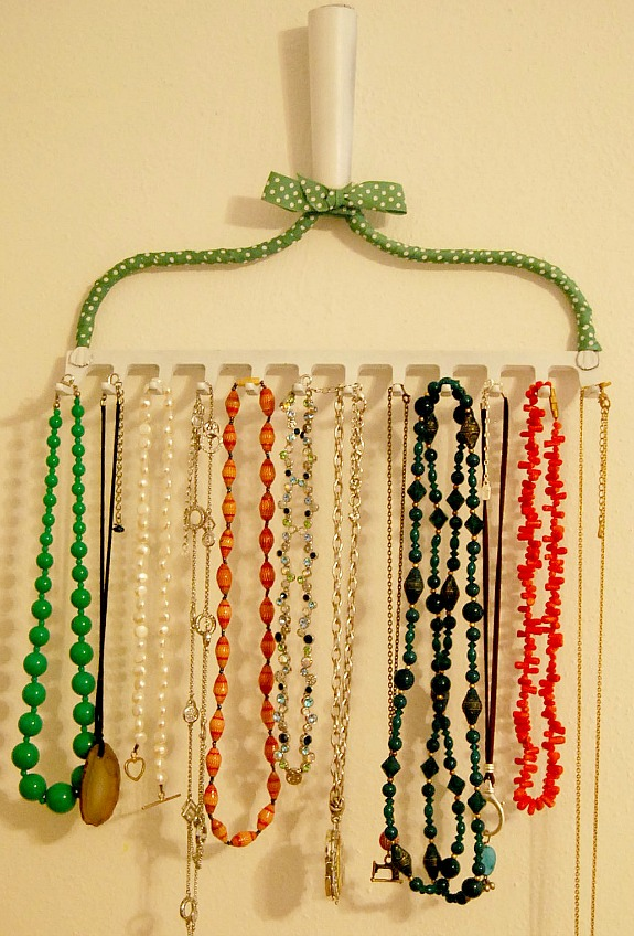 a rake repurposed into a necklace holder