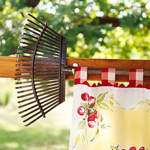 rake turned into a curtain rod for an outdoor room
