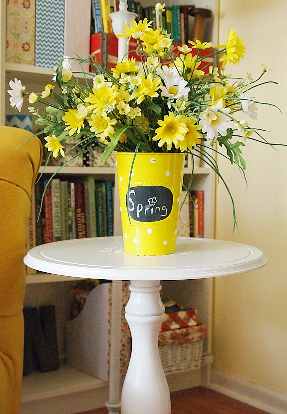 Yellow polka dot vase filled with spring flowers