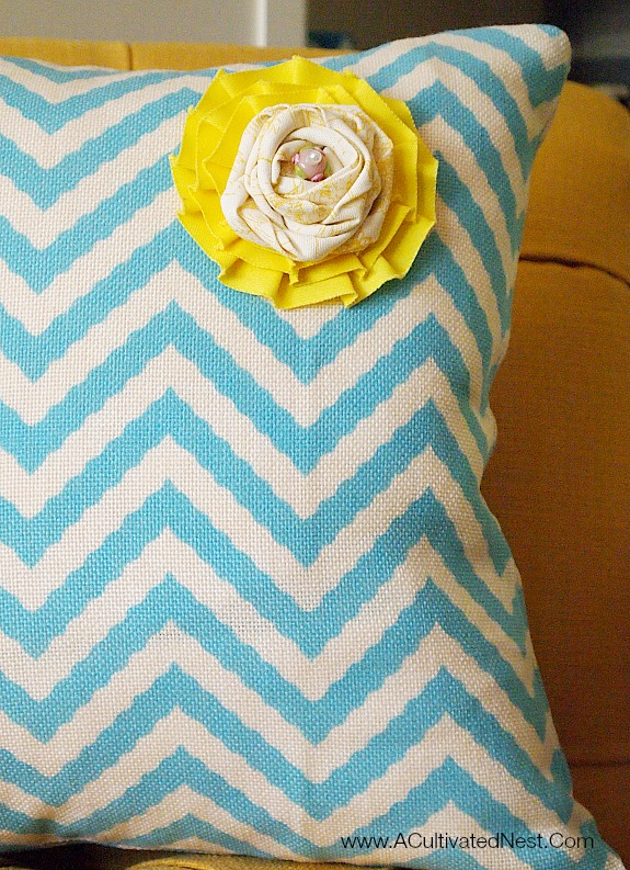 Yellow rosette on aqua chevron pillows