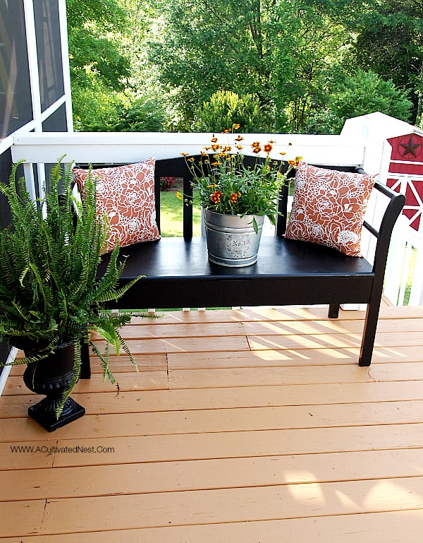 Black painted bench on deck - before and after makeover