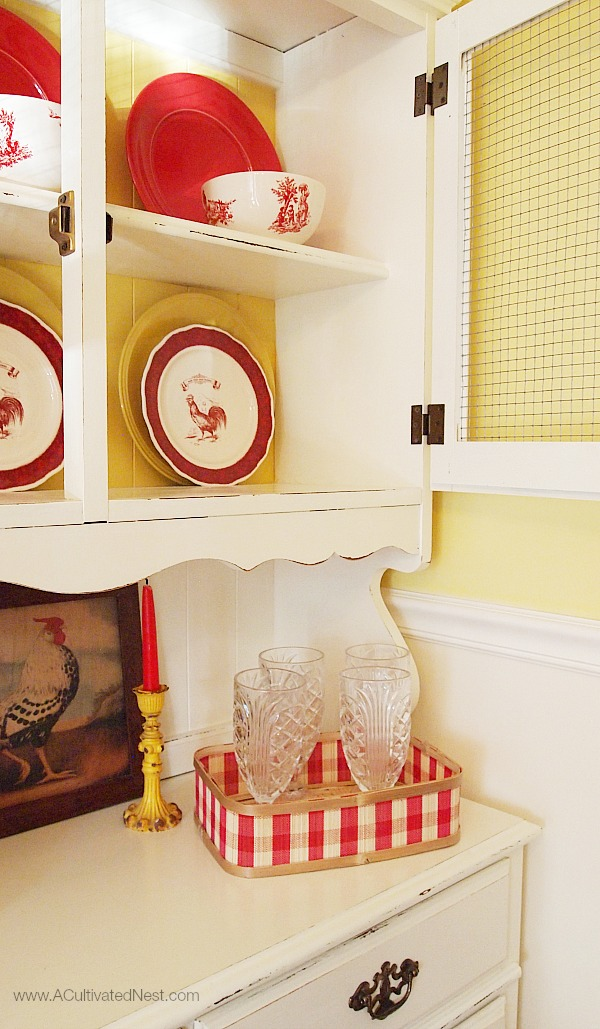 cottage china cabinet decorated with red and yellow plates, Country Living Rooster Plaes