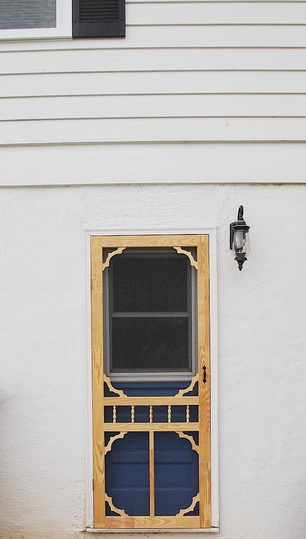 unpainted gingerbread screen door