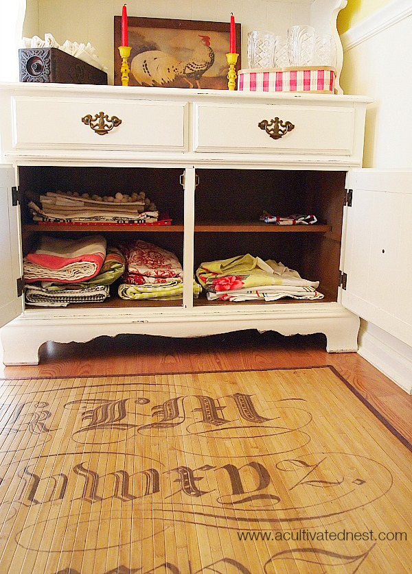 folded linen in a china cabinet bottom