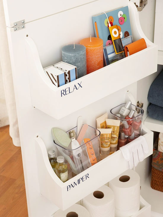 small bathroom organizing ideas: back of the cabinet door bathroom storage via BHG
