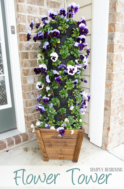 flower tower by Simply Desiging-These are great for adding vertical interest to your front porch or patio! 10 amazing tipsy pot and flower tower ideas. Tipsy pots are great for growing flowers AND vegetables. #containergardening #curbappeal #diy #gardening #acultivatednest