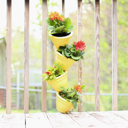 10 Amazing Flower Tower and Tipsy Pot Planter Ideas- These 10 DIY flower towers and tipsy pot planters are stunning ways to add vertical interest to your garden, porch, or front entry! | #tipsyPot #flowerTower #DIY #gardening #ACultivatedNest