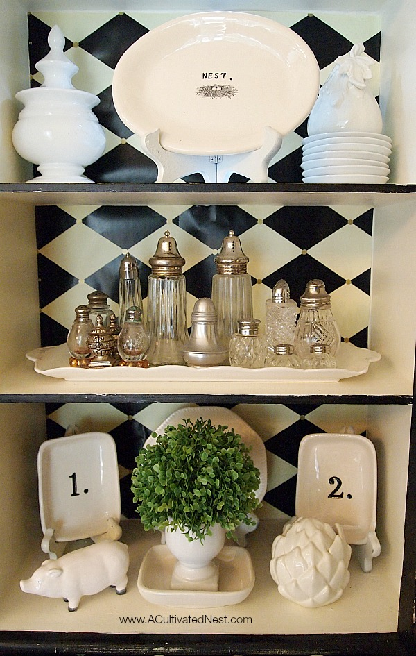 black and white themed china cabinet - white typography and numbered accessories