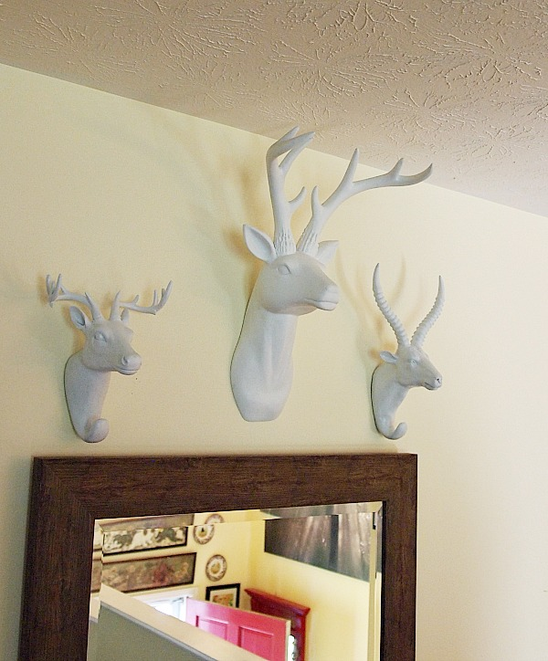 decorating with faux animal head mounts