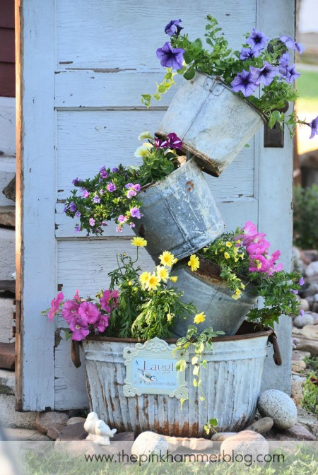 Galvanized tipsy pots by The Pink Hammer (flower tower round up)These are great for adding vertical interest to your front porch or patio! 10 amazing tipsy pot and flower tower ideas. Tipsy pots are great for growing flowers AND vegetables. #containergardening #curbappeal #diy #gardening #acultivatednest