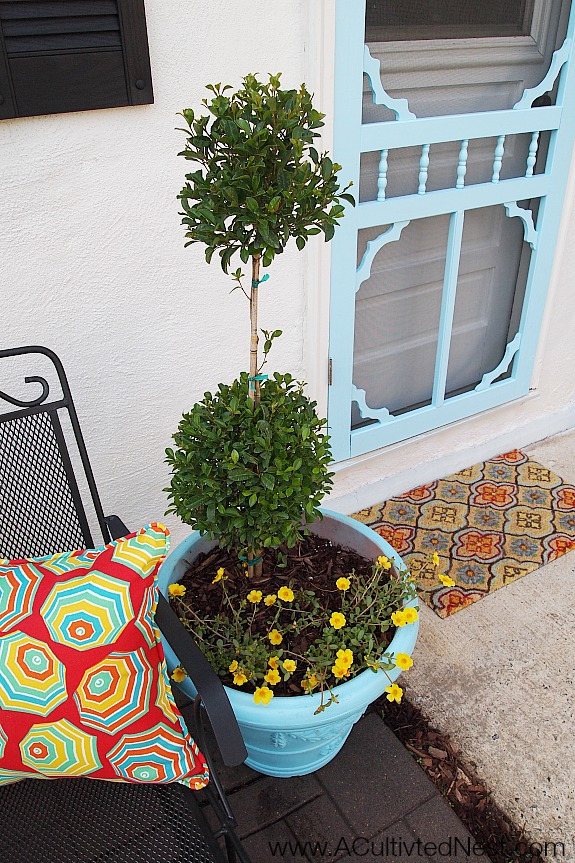 DIY Outdoor Projects: Back Door Seating Area Makeover - fun outdoor pillows and doormat complete the look for this back door makeover