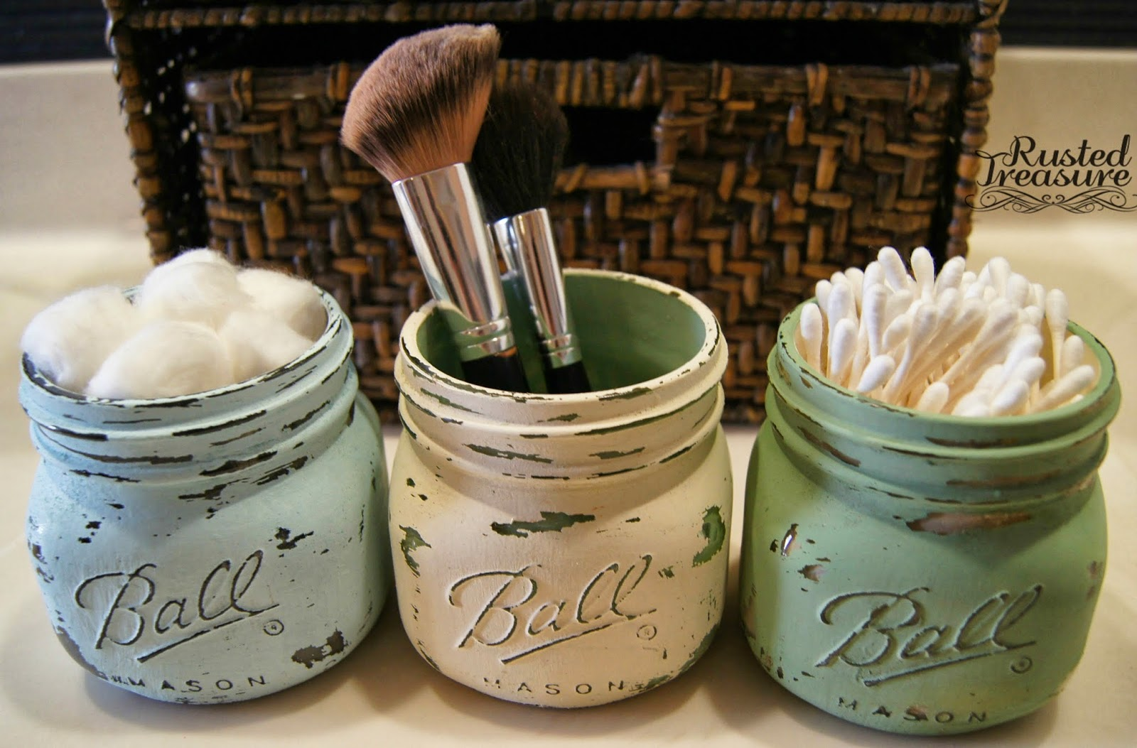 11 Fantastic Small Bathroom Organizing Ideas: Painted & distressed ball jars used for bathroom organization by Rusted Treasure