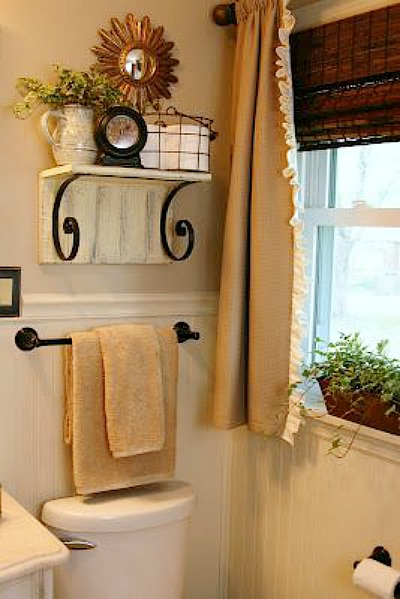 11 Fantastic Small Bathroom Organization Ideas: Put a shelf over toilet bathroom storage idea from The Butlers