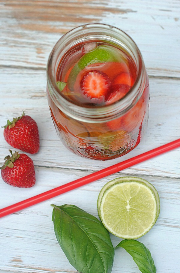strawberry basil lime infused water recipe in a mason jar