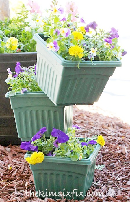 tiered flower pots from The Kim Six Fix (flower tower roundup)-These are great for adding vertical interest to your front porch or patio! 10 amazing tipsy pot and flower tower ideas. Tipsy pots are great for growing flowers AND vegetables. #containergardening #curbappeal #diy #gardening #acultivatednest
