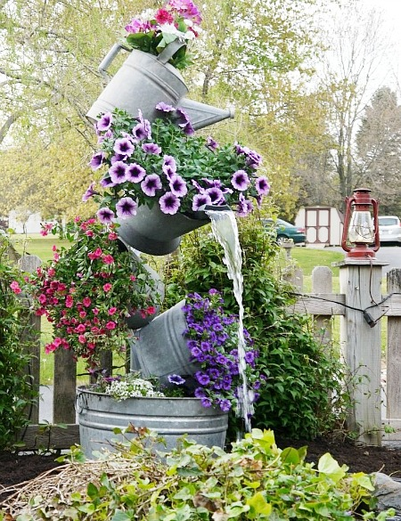 galvanized tipsy tower (round up of flower towers)
