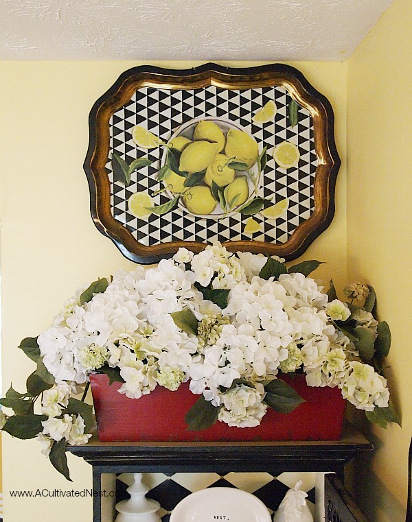 white hydrangea arrangement and lithographed tray