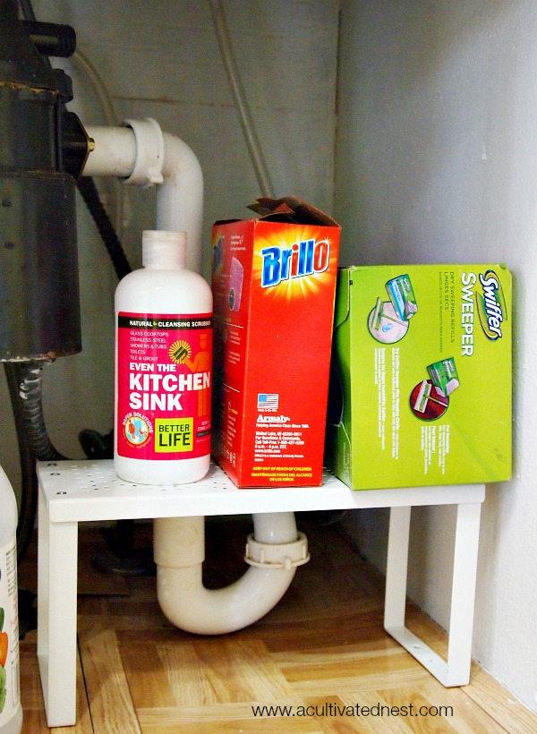 use expandable shelves to maximize space under your kitchen sink