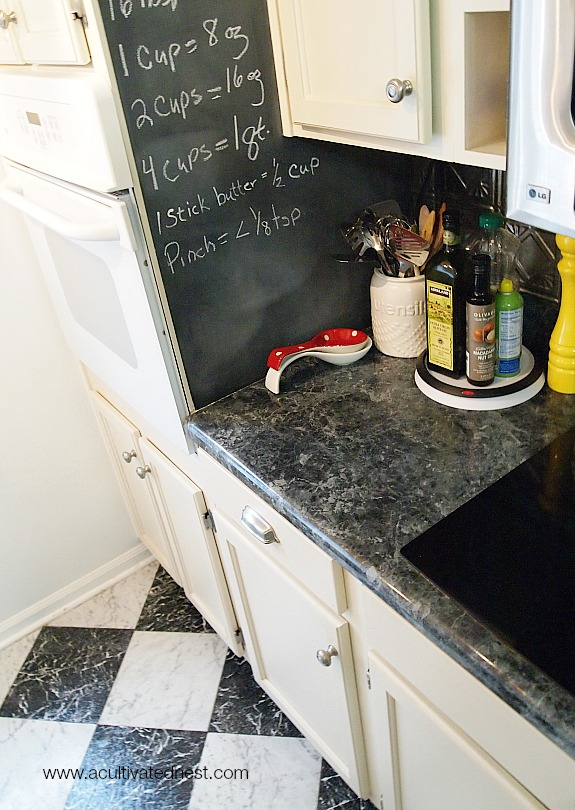 black and white marble checkerboard floor and chalkboard wall