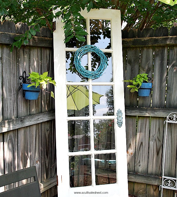 old french door repurposed in a garden
