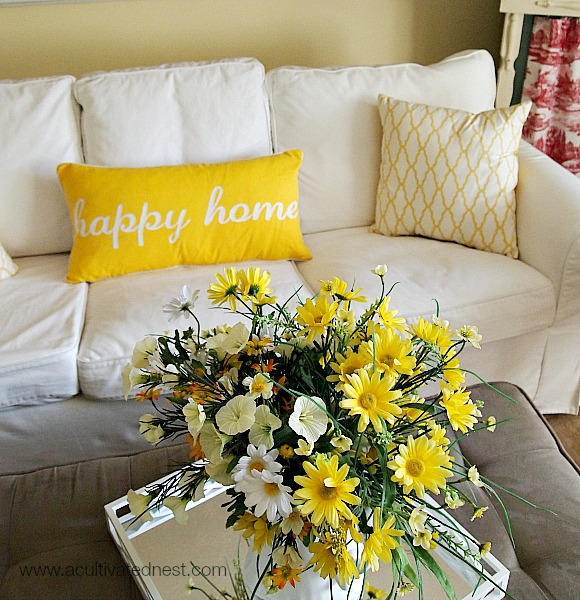 "Yellow and white ""Happy Home"" typography pillow"