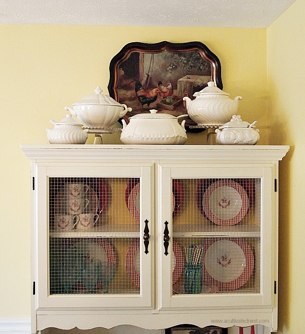 Dining room hutch makeover - soup tureen collection on top of hutch