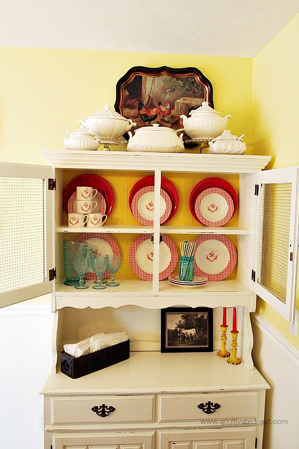 Colorful cottage style china cabinet
