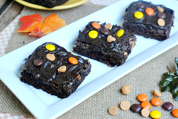 Delicious from scratch brownies decorated with Reese's Pieces for a fun fall look