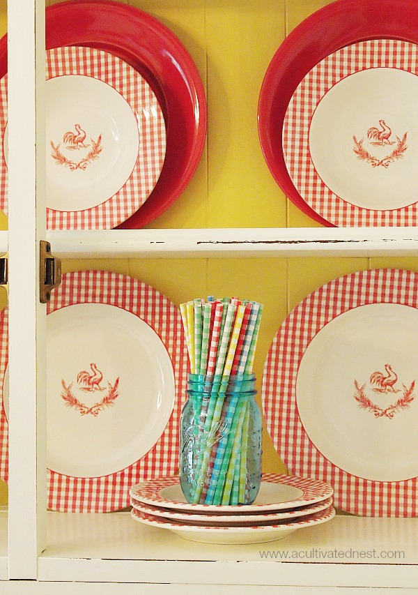 Colorful gingham straws in a blue canning jar {china hutch makeover}