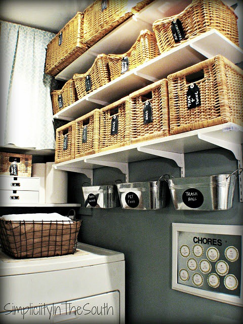 organizing a laundry room with baskets via Simplicity In The South