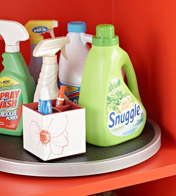 corral laundry items on a lazy susan via BHG