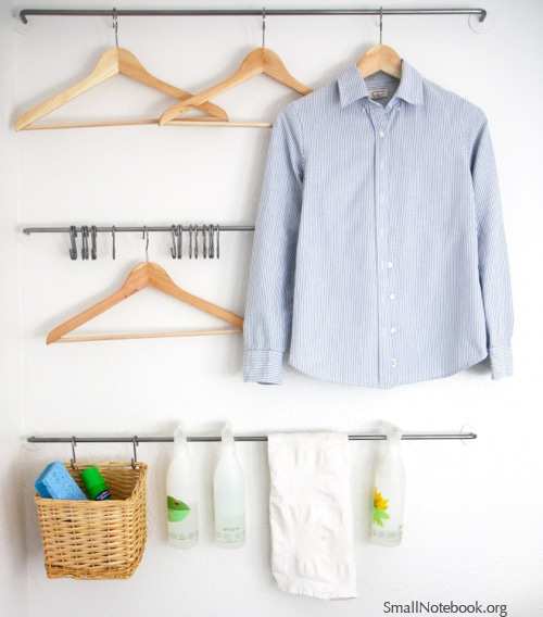 Laundry Room Organization - wall organizer via Small Notebook