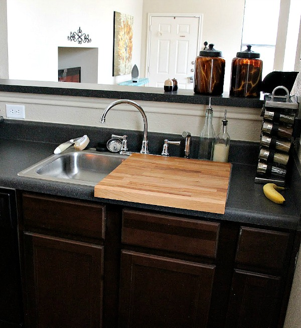 10 Ideas For Organizing A Small Kitchen- Sink cutting board. | how to organize a small space, organize an apartment, organize a tiny kitchen, #homeOrganization #organizing #kitchen #organization #organizingTips #organize