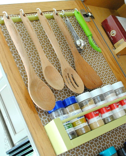 10 Ideas For Organizing A Small Kitchen- Inner cabinet door spice and utensil organizer. | how to organize a small space, organize an apartment, organize a tiny kitchen, #homeOrganization #organizing #kitchen #organization #organizingTips #organize