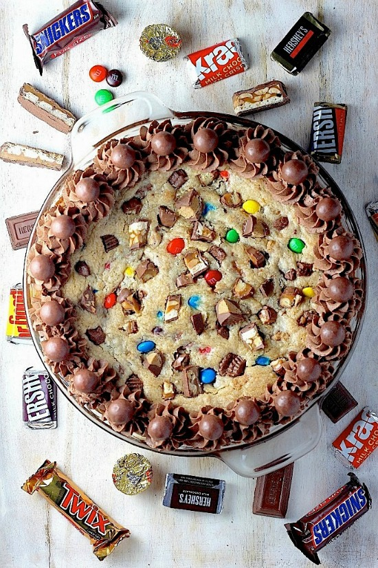 Great ideas for using up leftover Halloween candy like this candy cookie cake from Baker By Nature