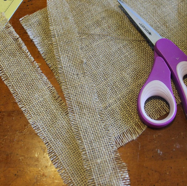 cut burlap into strips for napkin rings